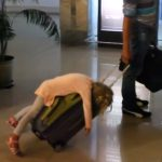 Watch: You Know You've Worn Your Kid Out When They Pass Out On Top Of Your Rolling Suitcase