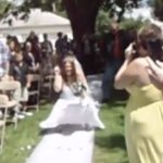 Watch: This Ridiculous Down The Aisle Wedding Dance Is So Bad A Dad Had To Cover His Kid's Ears